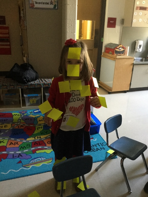 Students covered in sticky notes.