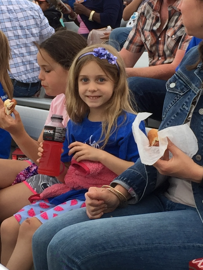 A students enjoys the refreshments from the concession stands.