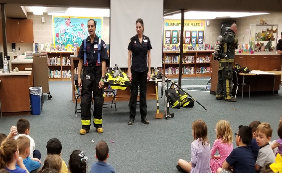 Fire Fighters explain the different parts of a fire fighting uniform and the tools fire fighters use.