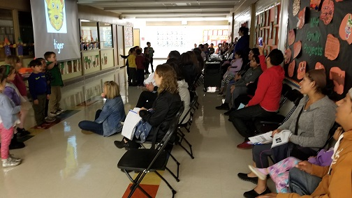 Parents learn our Letter/Sound Song at MDLKC Family Reading Night.