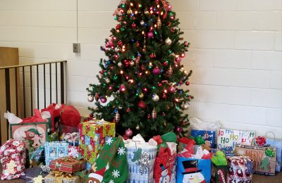 Staff helps bring holiday cheer to local families.