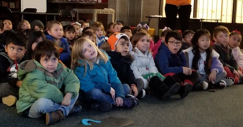 Students watch a musical about Antarctica.