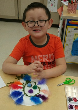 Aiden shows off his very own pompom hat!